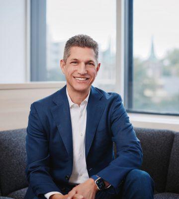 JORDAN GNATDIRECTOR & CEO